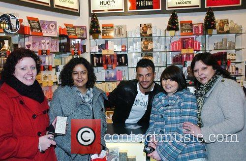 Peter Andre with fans promoting his new fragrance...