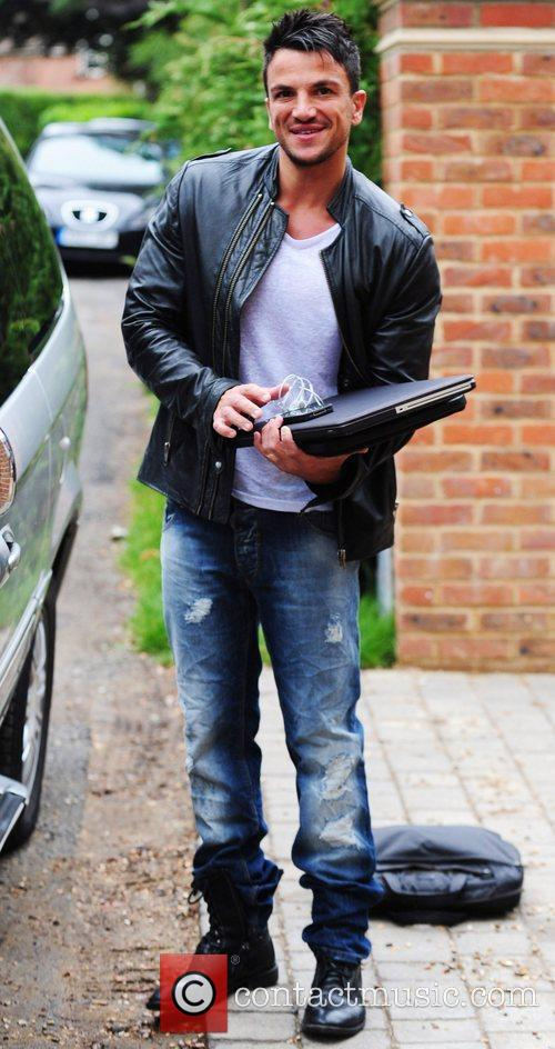 Out and about in Surrey with his laptop
