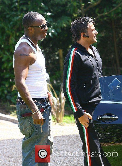 Peter Andre arriving at his new house with...