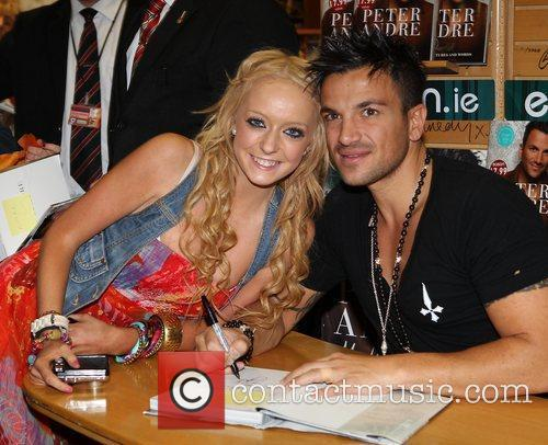 Peter Andre aand fan Ciara Smith signing his...