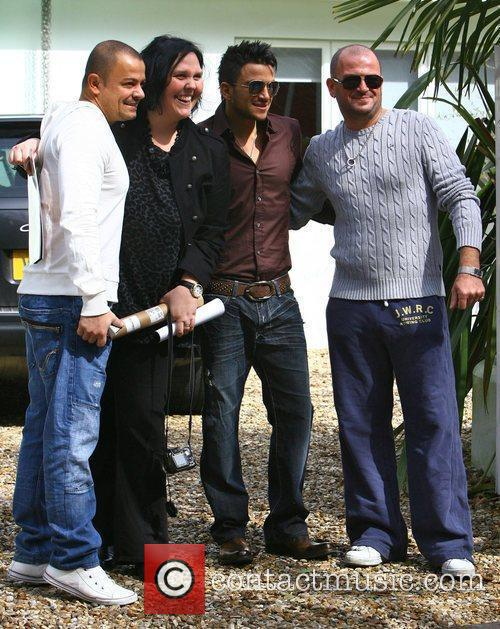 Peter Andre poses for fans with his brothers...