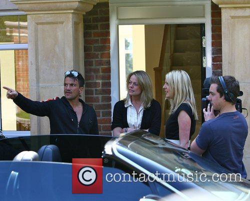 Peter Andre at his new house with a...