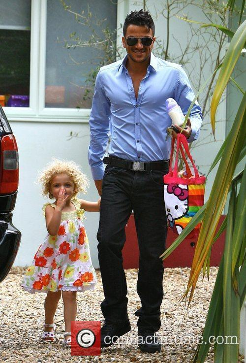Peter Andre leaves his house with daughter Princess...