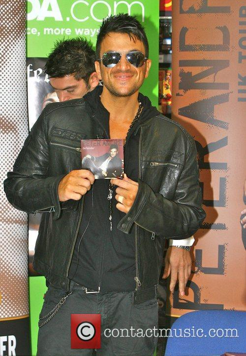 Signs copies of his new single 'Defender' at...