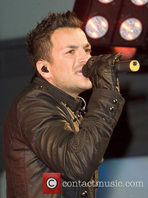 Peter Andre performing live at a free concert,...