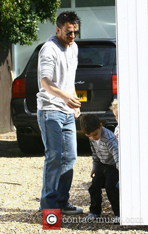 Peter Andre outside his house with his son...