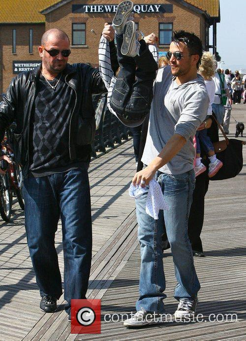Peter Andre with his brother Chris Andre and...