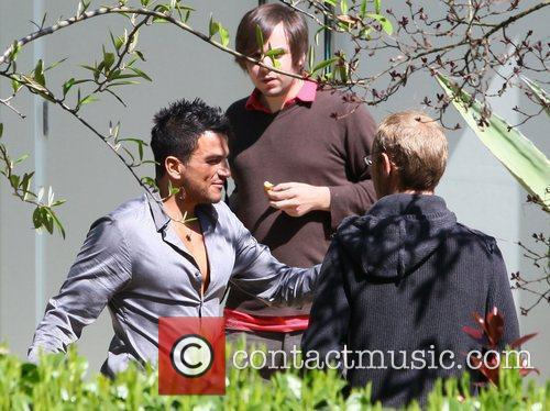 Peter Andre taking part in a photoshoot outside...