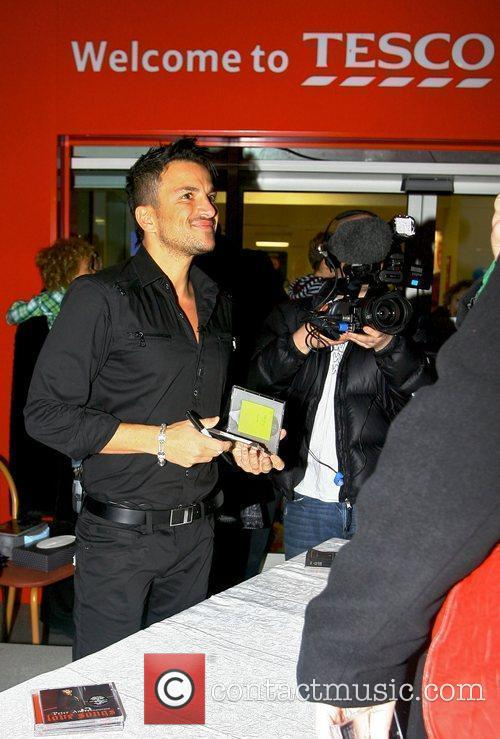Promotes and signs copies of his new album...