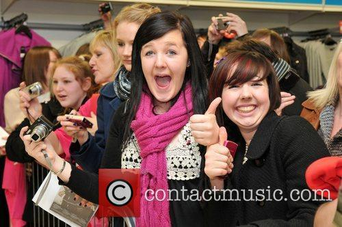 Fans Peter Andre signs copies of his new...