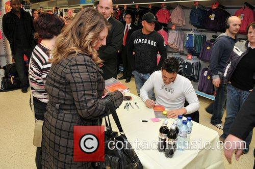 Peter Andre  signs copies of his new...