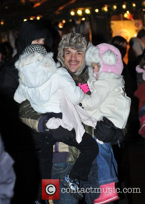 Peter Andre carrying Junior and Princess Tiaamii...