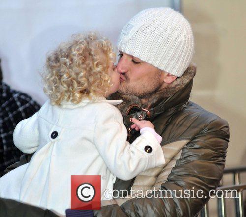 Peter Andre kisses Princess Tiaamii  at 'Winter...