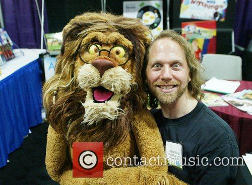 Attends a book signing for 'Between the Lions'...