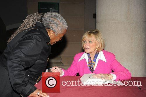 Kitty Kelly signs copies of her new book...