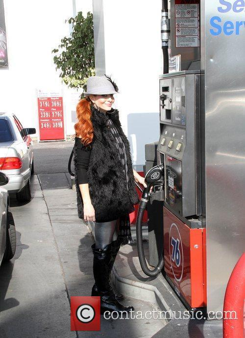Stops at a gas station to fill up...