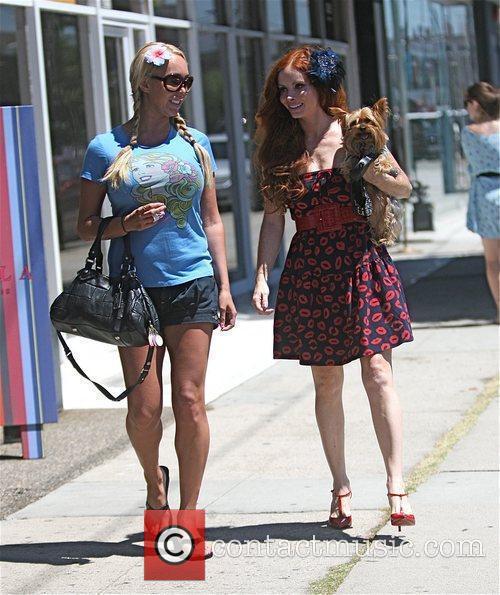 Mary Carey and Phoebe Price walk Phoebe's dog...