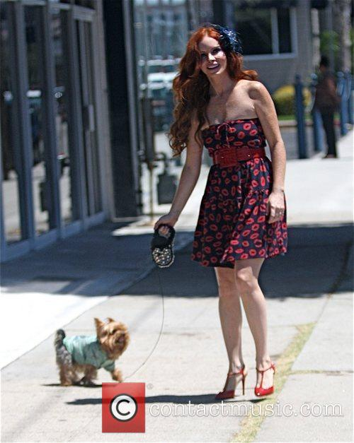 Phoebe Price walks her dog after having lunch...