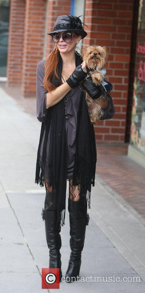 Phoebe Price running errands in Beverly Hills with...