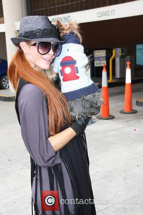 Running errands in Beverly Hills with her dog...