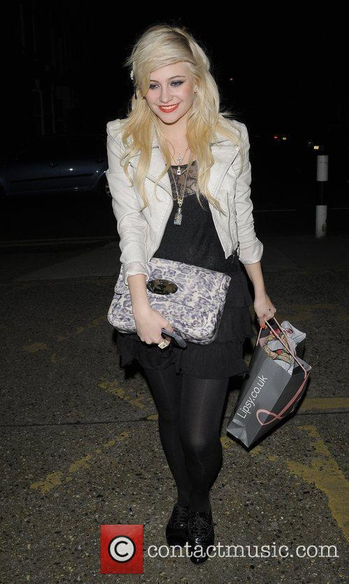 Pixie Lott arriving at a photographic studio in...