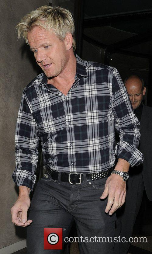 Is seen arriving at his restaurant Maze to...