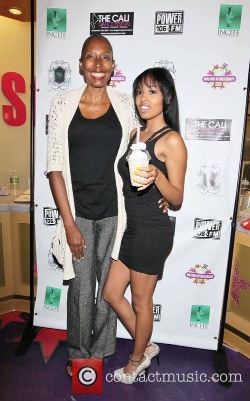 Guest and Jamila Hendricks Power 106 charity event...
