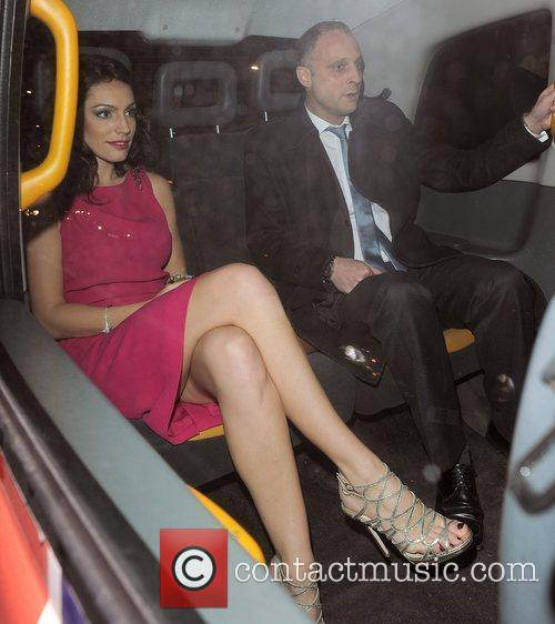 Kelly Brook and a male companion leaving the...