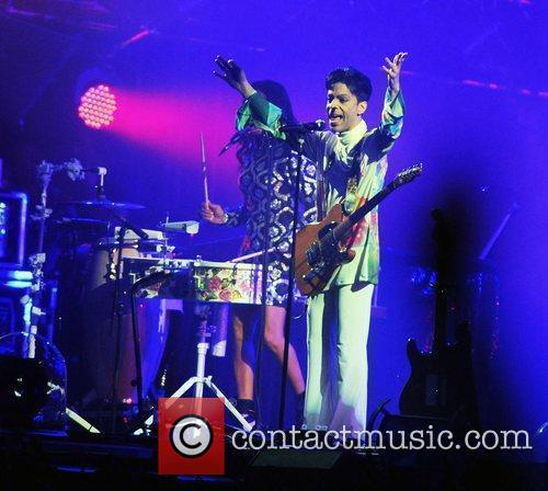 Prince performs live at the Roskilde Festival 2010...
