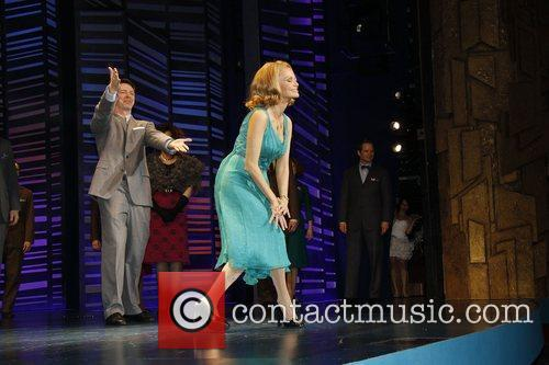 Sean Hayes and Kristin Chenoweth on stage during...