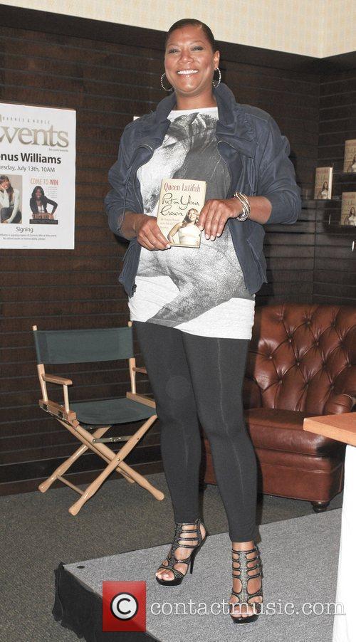 Queen Latifah signs copies of her new book...