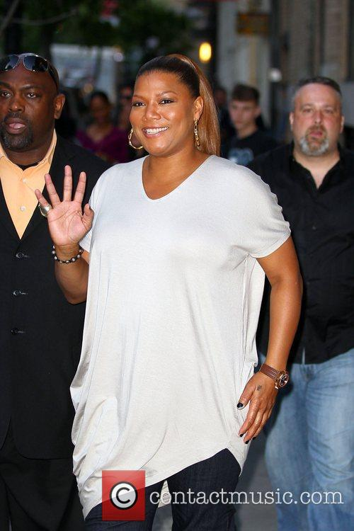 Queen Latifah walking with friends in Soho before...