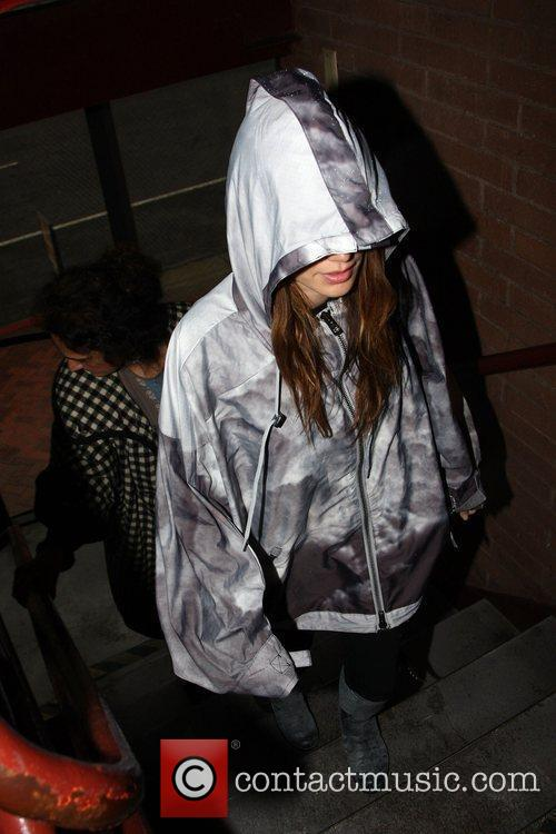 Keeps her hood up while leaving a medical...