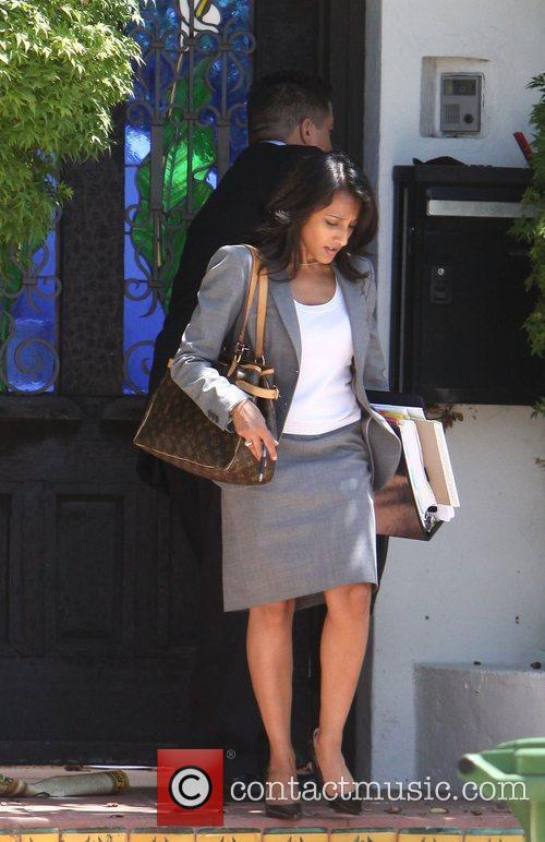 Detectives visit the home of Rachel Bilson in...