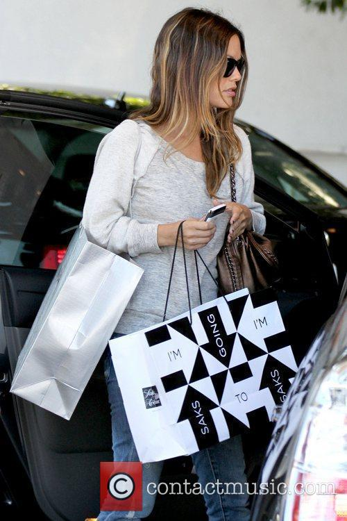Leaving Saks Fifth Avenue in Hollywood after shopping