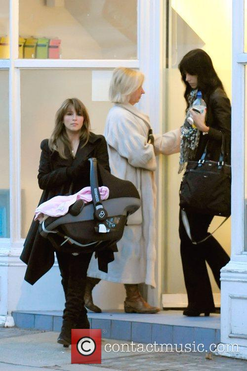 Leaving the Primsrose Hill surgery carrying her baby