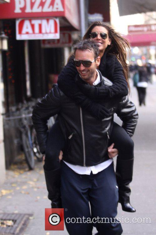 Gets a piggyback ride to her apartment after...