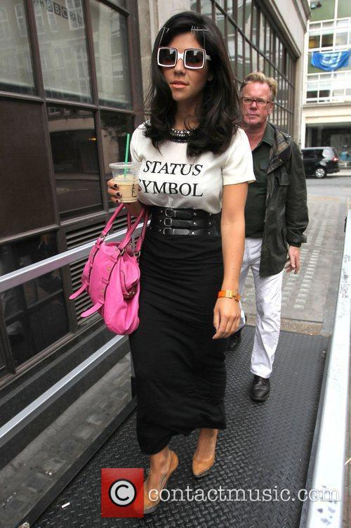 Arrives at the BBC Radio 1 studios wearing...