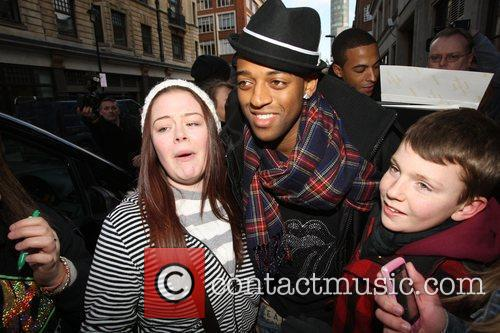 Oritse Williams posing with fans JLS leaving the...