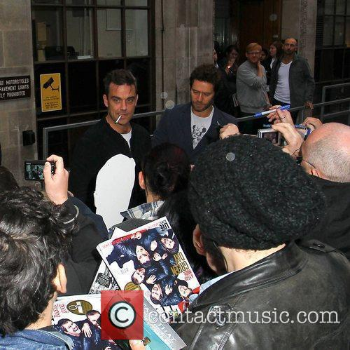 Robbie Williams and Howard Donald Take That leave...
