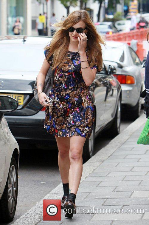 Arrives at the BBC Radio 1 studios