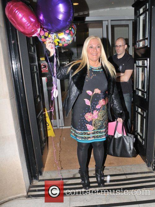 Vanessa Feltz carries a handful of 'Good Luck'...