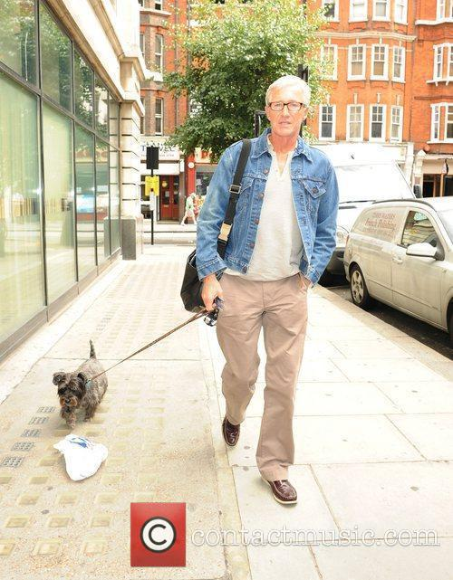 Paul O'Grady with his dog Olga outside the...