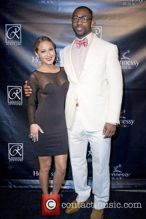 Adrienne Bailon and Darrelle Revis The Grand Opening...
