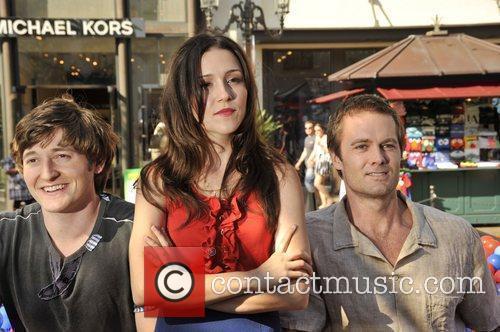 Stars of the new show 'Raising Hope' hold...