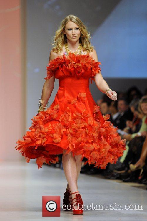 Ashleigh Mcivor wear a dress by Fashion Crimes...