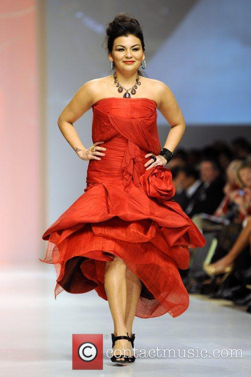Crystal Shawanda wears a dress by Paul Hardy...