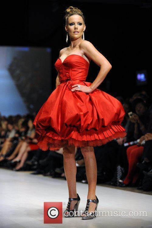 Kathleen Robertson wears a dress by Mark Belford...