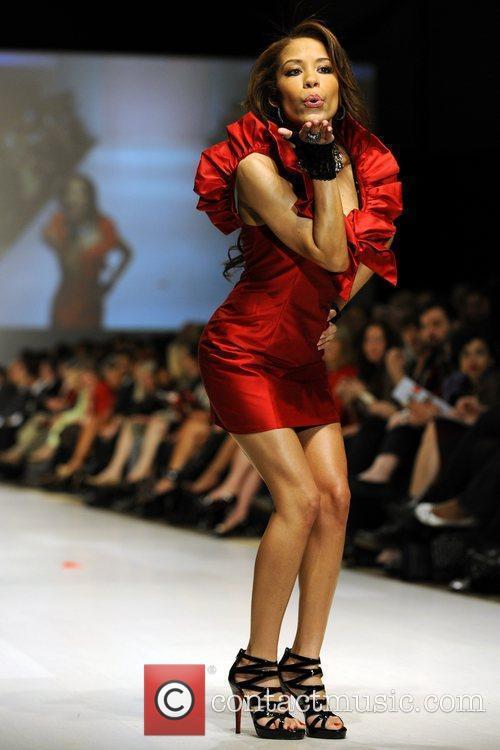 Keshia Chante wears a dress by Jason Meyers...