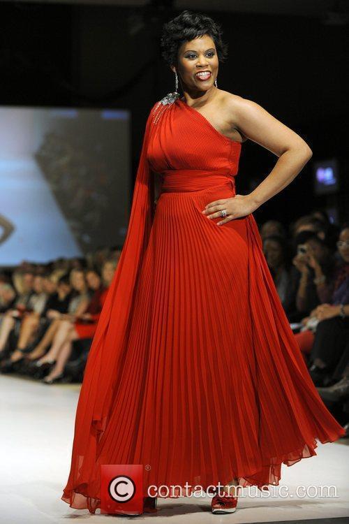 Marci Ien wears a dress by Ross Mayer...